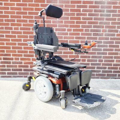 Pride Quantum 6 Edge Power Chair in orange - three quarter view