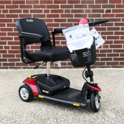 Pride Elite Traveller three wheeled mobility scooter - red - three quarter view