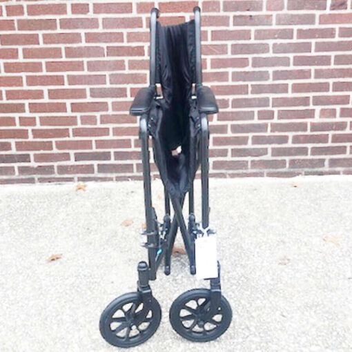 Invacare Transport foldable wheelchair - front view folded position