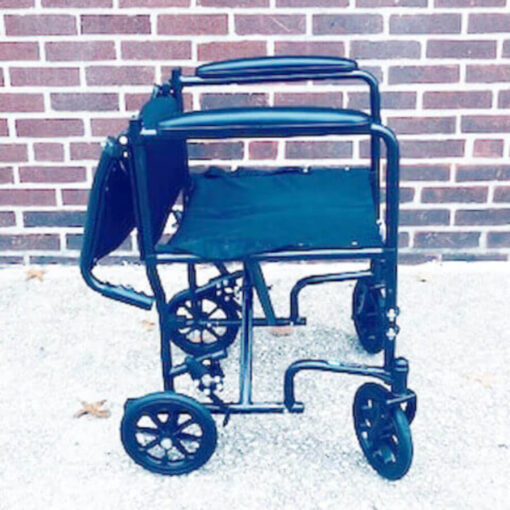 Invacare Transport foldable wheelchair - right profile with backseat in down position