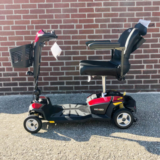 Pride GoGo LX with CTS Suspension four wheel mobility scooter - red - left side view