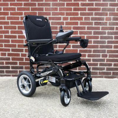 Pride Jazzy Passport electric wheelchair - black - three quarter view