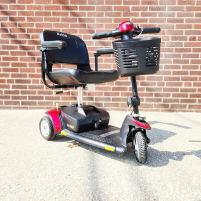 Pride GoGo Elite Traveller three wheel mobility scooter in red - Three quarter view